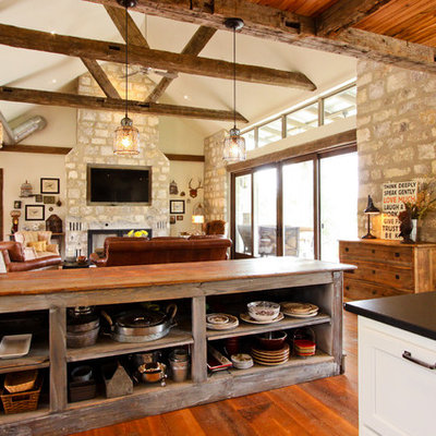 Example of a mountain style open concept kitchen design in Other with open cabinets and wood countertops