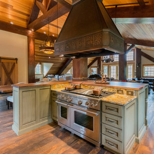 Large rustic open concept kitchen ideas - Large mountain style l-shaped dark wood floor open concept kitchen photo in Portland with a farmhouse sink, recessed-panel cabinets, distressed cabinets, granite countertops, stone slab backsplash, stainless steel appliances and an island