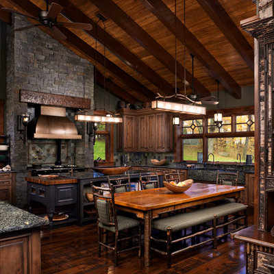 Example of a large mountain style u-shaped enclosed kitchen design in Other with raised-panel cabinets and medium tone wood cabinets