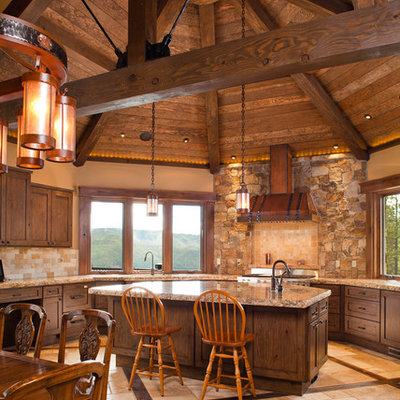 Inspiration for a huge rustic u-shaped travertine floor and beige floor open concept kitchen remodel in Denver with an undermount sink, shaker cabinets, dark wood cabinets, granite countertops, multicolored backsplash, stone tile backsplash, stainless steel appliances and an island