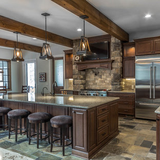 Huge rustic eat-in kitchen ideas - Eat-in kitchen - huge rustic l-shaped slate floor and green floor eat-in kitchen idea in Detroit with an undermount sink, raised-panel cabinets, medium tone wood cabinets, quartz countertops, beige backsplash, stone tile backsplash, stainless steel appliances and an island