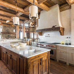 Rustic kitchen photos - Kitchen - rustic l-shaped dark wood floor kitchen idea in Other with recessed-panel cabinets, gray cabinets, white backsplash, stainless steel appliances and an island