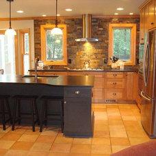 Rustic Kitchen by Essence Design Studios