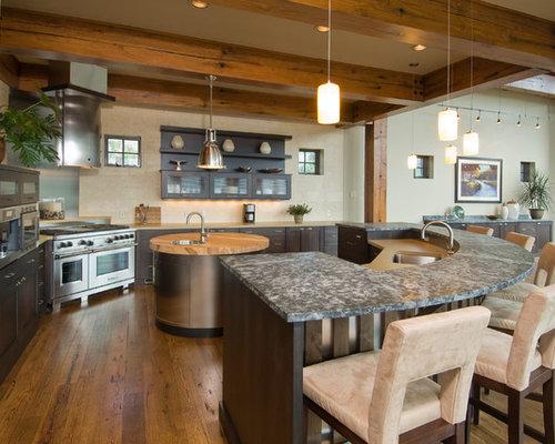 Mountain Style Kitchen Photo With An Undermount Sink, Dark Wood Cabinets,  Beige Backsplash And