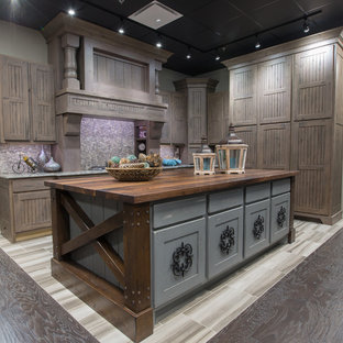 This is an example of a small country l-shaped separate kitchen in Austin with louvered cabinets, distressed cabinets, grey splashback, mosaic tile splashback, panelled appliances, porcelain floors, with island, beige floor, an undermount sink, quartzite benchtops and grey benchtop.