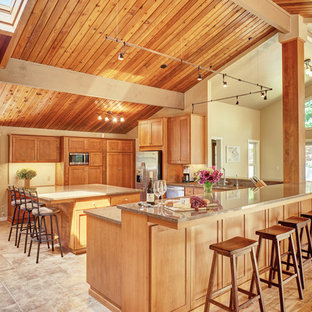 Photo of a large transitional open plan kitchen in Other with a double-bowl sink, shaker cabinets, medium wood cabinets, quartz benchtops, stainless steel appliances, ceramic floors and with island.