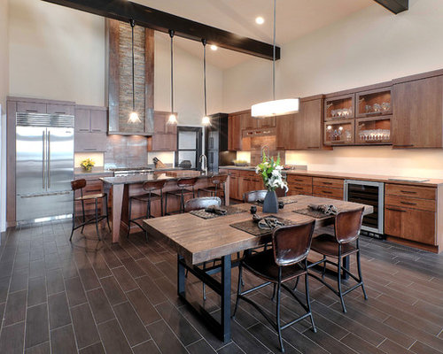 Inspiration for a large rustic l-shaped porcelain floor eat-in kitchen  remodel in