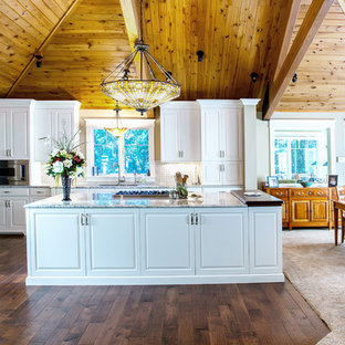 Rustic eat-in kitchen remodeling - Example of a mountain style dark wood floor eat-in kitchen design in Detroit with raised-panel cabinets, white cabinets, granite countertops, ceramic backsplash and an island