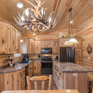 Design ideas for a mid-sized country l-shaped eat-in kitchen in Minneapolis with an undermount sink, shaker cabinets, medium wood cabinets, laminate benchtops, stainless steel appliances, linoleum floors, with island, multi-coloured floor and turquoise benchtop.