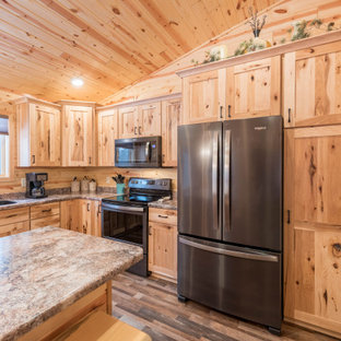 Photo of a mid-sized country l-shaped eat-in kitchen in Minneapolis with an undermount sink, shaker cabinets, medium wood cabinets, laminate benchtops, stainless steel appliances, linoleum floors, with island, multi-coloured floor and turquoise benchtop.