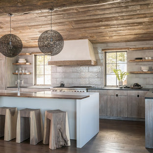 Rustic kitchen designs - Mountain style l-shaped medium tone wood floor and brown floor kitchen photo in Other with an undermount sink, louvered cabinets, medium tone wood cabinets, gray backsplash, paneled appliances, an island and gray countertops