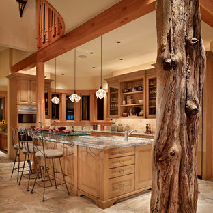 Inspiration for a large country l-shaped kitchen in Seattle with open cabinets, granite benchtops, beige splashback, stone tile splashback, porcelain floors, with island and medium wood cabinets.