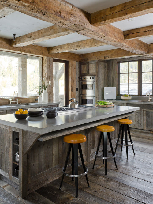 rustic kitchen idea with distressed cabinets stainless steel