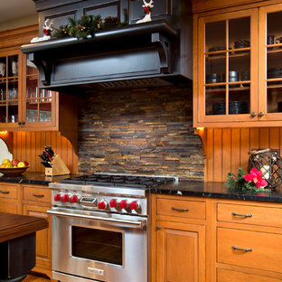 Traditional kitchen in Boston with stainless steel appliances and slate splashback.