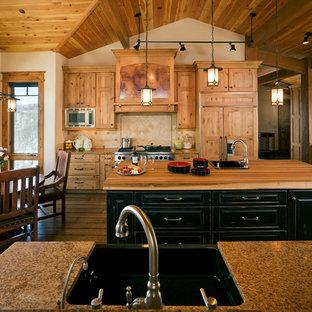 Rustic kitchen/diner in Denver with a single-bowl sink, shaker cabinets, light wood cabinets, granite worktops, beige splashback and integrated appliances.