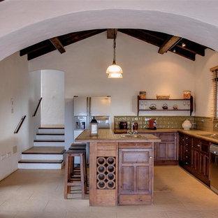 Idéer för att renovera ett avskilt, stort rustikt grön grönt u-kök, med en nedsänkt diskho, luckor med upphöjd panel, skåp i mörkt trä, kaklad bänkskiva, brunt stänkskydd, stänkskydd i cementkakel, rostfria vitvaror och en halv köksö