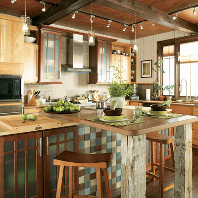 Example of a trendy kitchen design in Dallas with flat-panel cabinets