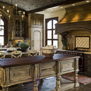 Example of a cottage chic kitchen design in Phoenix with distressed cabinets