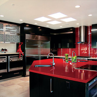 Inspiration for a contemporary kitchen in Phoenix with stainless steel appliances, an undermount sink, flat-panel cabinets, black cabinets, quartz benchtops, red splashback and red benchtop.
