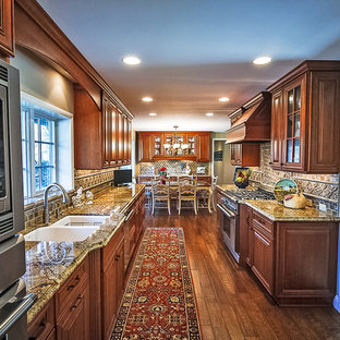 Mid-sized traditional eat-in kitchen pictures - Eat-in kitchen - mid-sized traditional u-shaped medium tone wood floor and brown floor eat-in kitchen idea in Sacramento with an undermount sink, raised-panel cabinets, medium tone wood cabinets, granite countertops, porcelain backsplash, stainless steel appliances, no island and brown backsplash