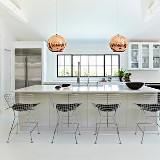 This is an example of a large modern l-shaped open plan kitchen in New York with a submerged sink, recessed-panel cabinets, white cabinets, granite worktops, brown splashback, stainless steel appliances, lino flooring and an island.