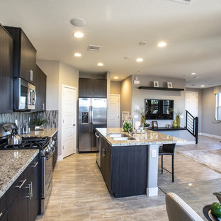 Inspiration for a mid-sized eclectic l-shaped eat-in kitchen in Las Vegas with a double-bowl sink, flat-panel cabinets, dark wood cabinets, granite benchtops, multi-coloured splashback, matchstick tile splashback, stainless steel appliances, marble floors and with island.