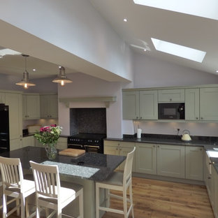 sage green painted shaker in large open plan kitchen