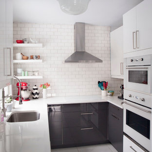 Small contemporary enclosed kitchen remodeling - Inspiration for a small contemporary u-shaped enclosed kitchen remodel in Montreal with an undermount sink, flat-panel cabinets, gray cabinets, white backsplash, subway tile backsplash and white appliances