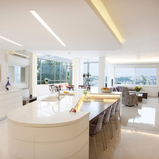 Trendy open concept kitchen photo in Tel Aviv with flat-panel cabinets and white cabinets