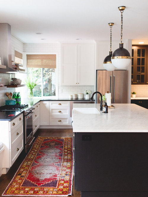 example of a transitional u shaped kitchen design in new york with a farmhouse sink - Kitchen Island Lighting Ideas Pictures