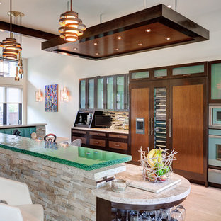 Photo of a contemporary kitchen in Houston with glass-front cabinets, dark wood cabinets, glass benchtops, multi-coloured splashback, matchstick tile splashback, panelled appliances and green benchtop.