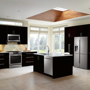 Large transitional kitchen remodeling - Inspiration for a large transitional l-shaped ceramic floor kitchen remodel in Vancouver with an undermount sink, flat-panel cabinets, black cabinets, marble countertops, multicolored backsplash, matchstick tile backsplash, stainless steel appliances and an island