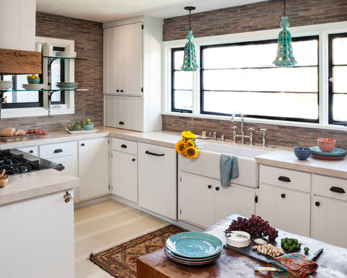 Eclectic U Shaped Enclosed Kitchen Photo In Orange County With A Farmhouse  Sink, Flat