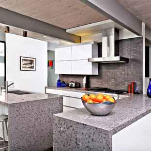 Kitchen - modern l-shaped kitchen idea in San Diego with a double-bowl sink, flat-panel cabinets, white cabinets and gray backsplash