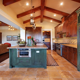 Photo of a large arts and crafts l-shaped open plan kitchen in San Diego with an undermount sink, recessed-panel cabinets, dark wood cabinets, multi-coloured splashback, stainless steel appliances, granite benchtops, ceramic splashback, ceramic floors, with island and multi-coloured floor.