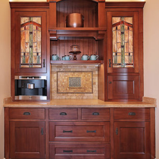 Design ideas for a small arts and crafts l-shaped kitchen in San Diego with an undermount sink, recessed-panel cabinets, dark wood cabinets, granite benchtops, multi-coloured splashback, ceramic splashback, stainless steel appliances, ceramic floors, with island and multi-coloured floor.