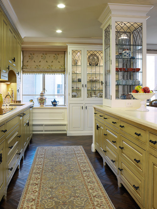 Ex&le of a classic kitchen design in San Francisco with glass-front cabinets & Leaded Glass Cabinet Doors | Houzz kurilladesign.com