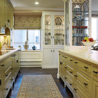 Traditional kitchen photos - Example of a classic kitchen design in San Francisco with glass-front cabinets