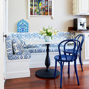 Mid-sized eclectic eat-in kitchen photos - Eat-in kitchen - mid-sized eclectic single-wall medium tone wood floor eat-in kitchen idea in San Francisco with raised-panel cabinets, white cabinets and granite countertops