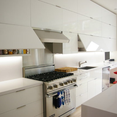 Inspiration for a modern kitchen remodel in San Francisco with an undermount sink, flat-panel cabinets and white cabinets