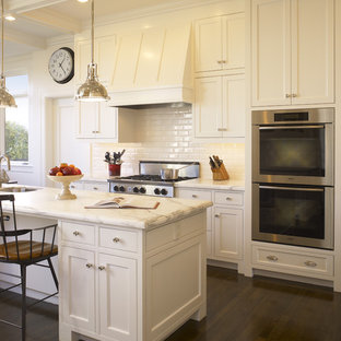 Inspiration for a traditional kitchen in San Francisco with beaded inset cabinets, subway tile splashback, stainless steel appliances, white cabinets, marble benchtops and white splashback.