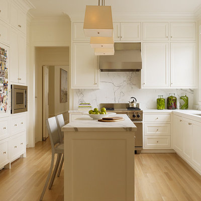 Elegant kitchen photo in San Francisco with stainless steel appliances and marble backsplash
