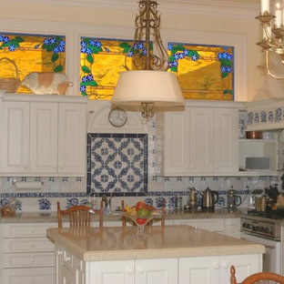 Large victorian kitchen appliance - Large ornate u-shaped kitchen photo in San Francisco with an undermount sink, recessed-panel cabinets, white cabinets, granite countertops, blue backsplash, ceramic backsplash, white appliances and an island