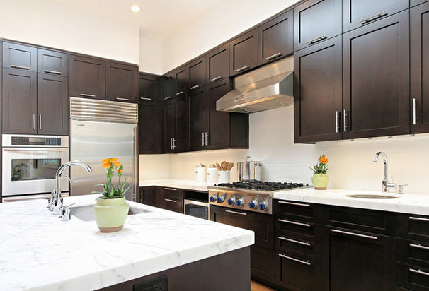 Transitional Kitchen by Dijeau Poage Construction
