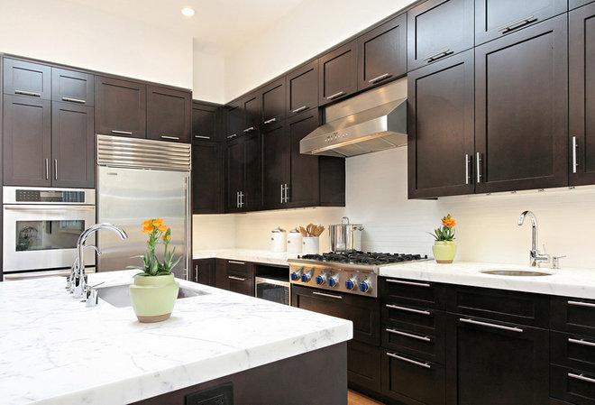Transitional Kitchen by Dijeau Poage Construction