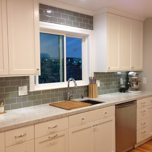 Transitional eat-in kitchen ideas - Example of a transitional l-shaped eat-in kitchen design in San Francisco with an undermount sink, shaker cabinets, white cabinets, quartz countertops, green backsplash, porcelain backsplash and stainless steel appliances