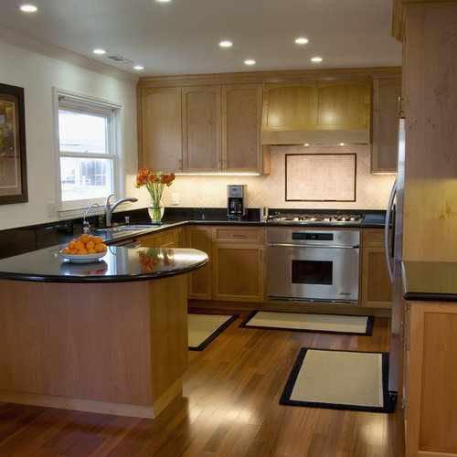 Elegant kitchen photo in San Francisco with stainless steel appliances, an  undermount sink, shaker