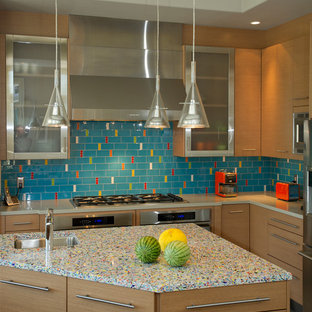 Design ideas for a mid-sized contemporary l-shaped separate kitchen in San Francisco with recycled glass benchtops, stainless steel appliances, flat-panel cabinets, medium wood cabinets, an undermount sink, multi-coloured splashback, glass tile splashback, porcelain floors and with island.