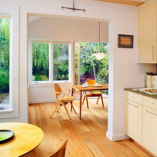 Large contemporary eat-in kitchen photos - Example of a large trendy medium tone wood floor eat-in kitchen design in San Francisco with flat-panel cabinets, light wood cabinets, an undermount sink, stainless steel appliances and no island