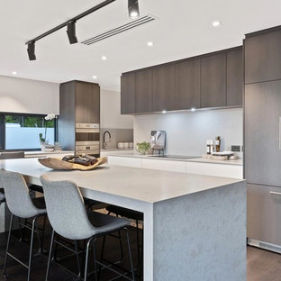 Inspiration for a contemporary kitchen in Perth with flat-panel cabinets, brown cabinets, grey splashback, panelled appliances, dark hardwood floors, with island, brown floor and grey benchtop.